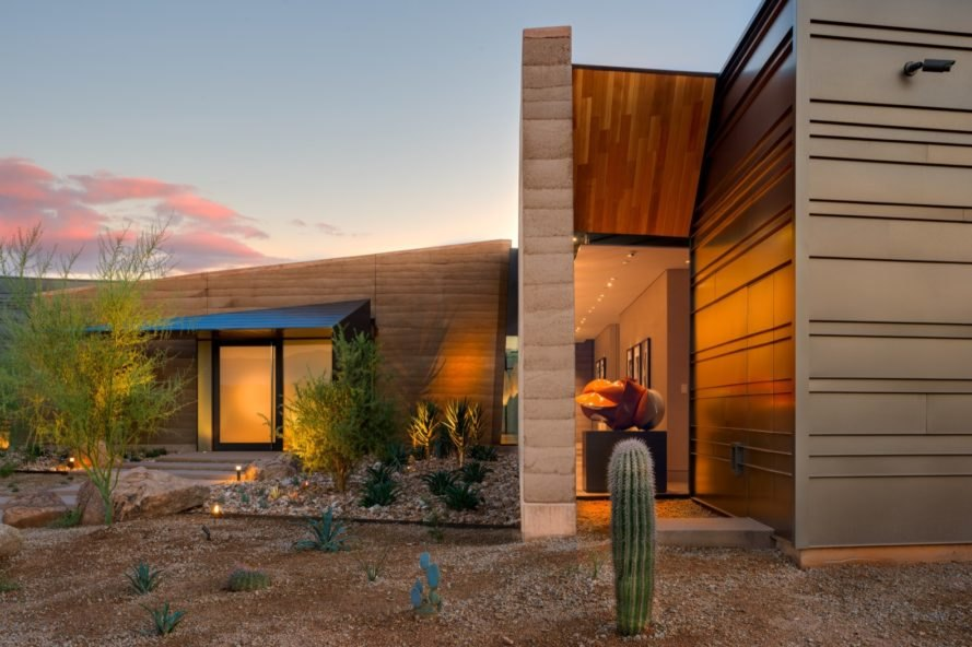 rammed earth home in desert