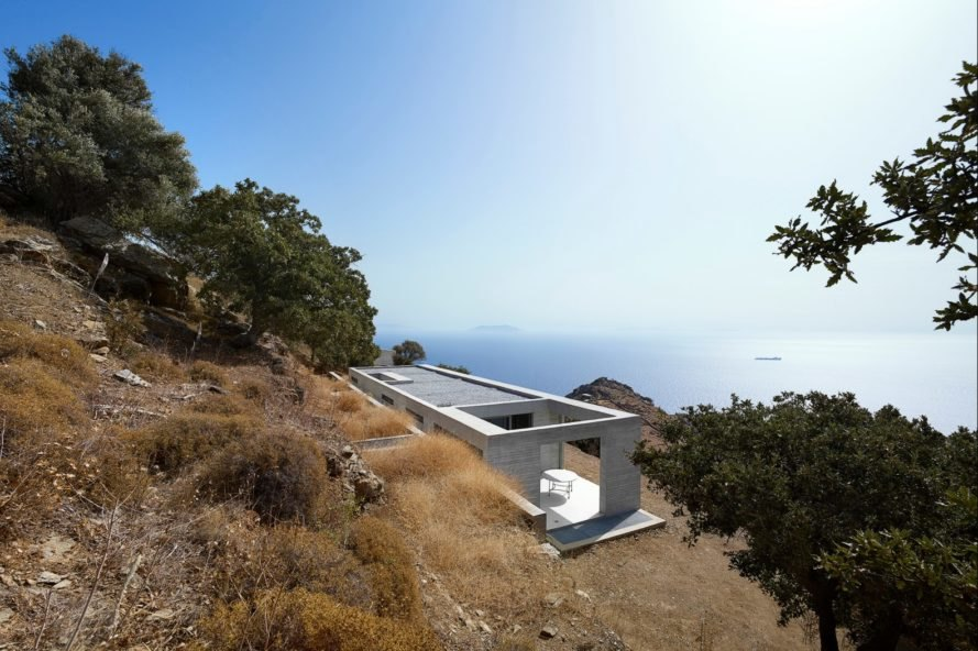 elongated white home looking out onto the sea