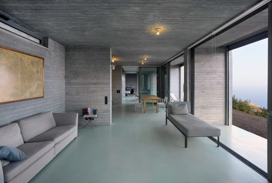 interior concrete living space with modern furniture