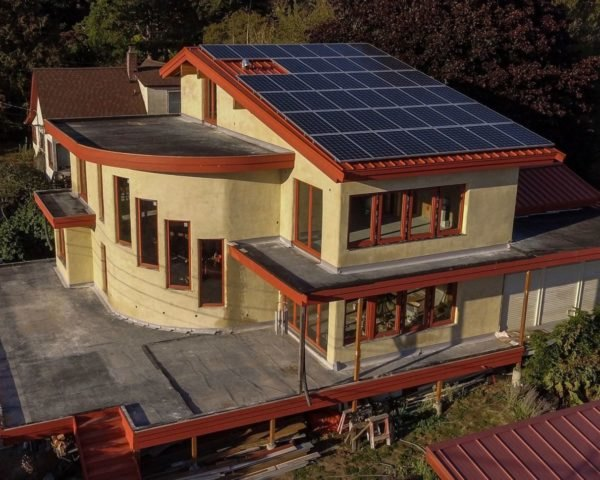 home design with slanted roof covered in solar panels