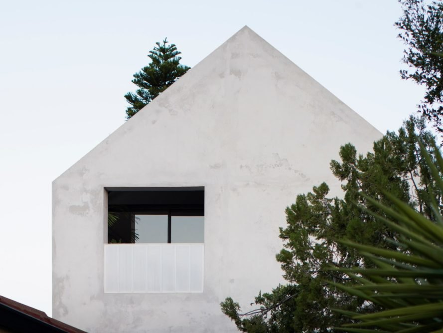 A-frame concrete home with large window