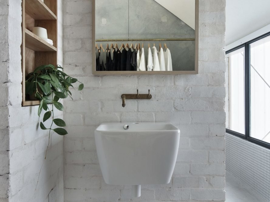 bathroom with white sink and mirror