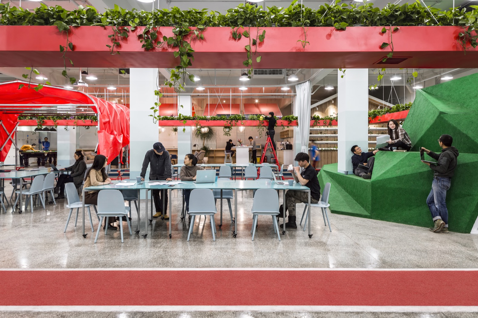 """Hydroponic gardens and a """"mini mountain"""" promote fun and well-being in this creative office"""
