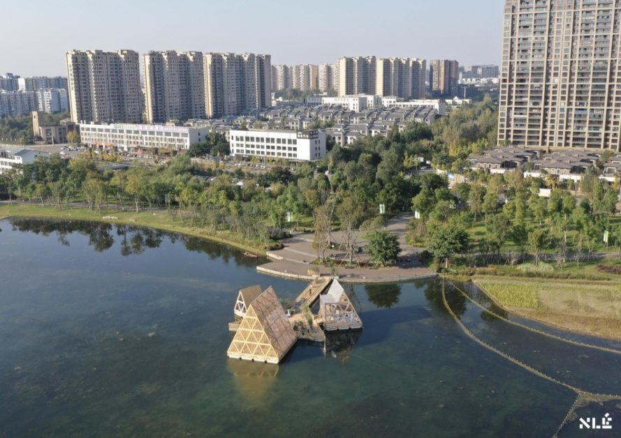 aerial view of triangular wood structures floating on water