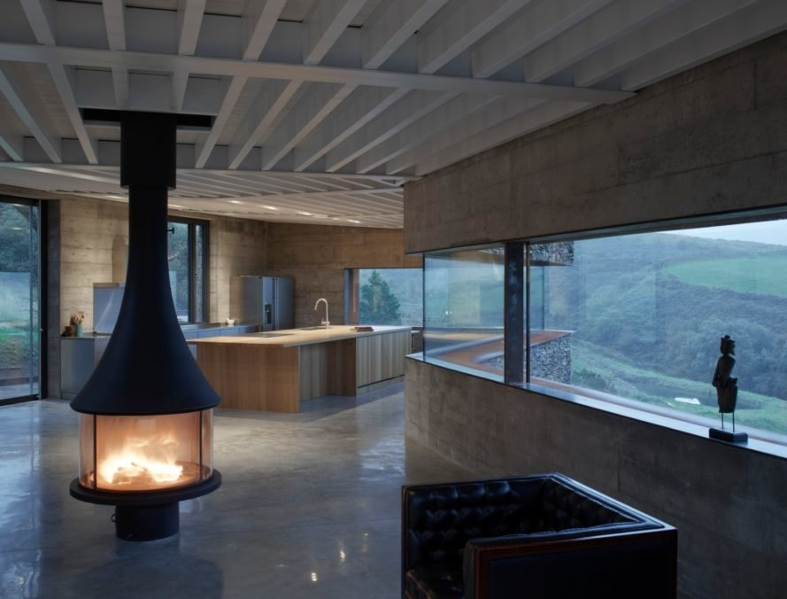 interior of home with large chimney in middle of living space