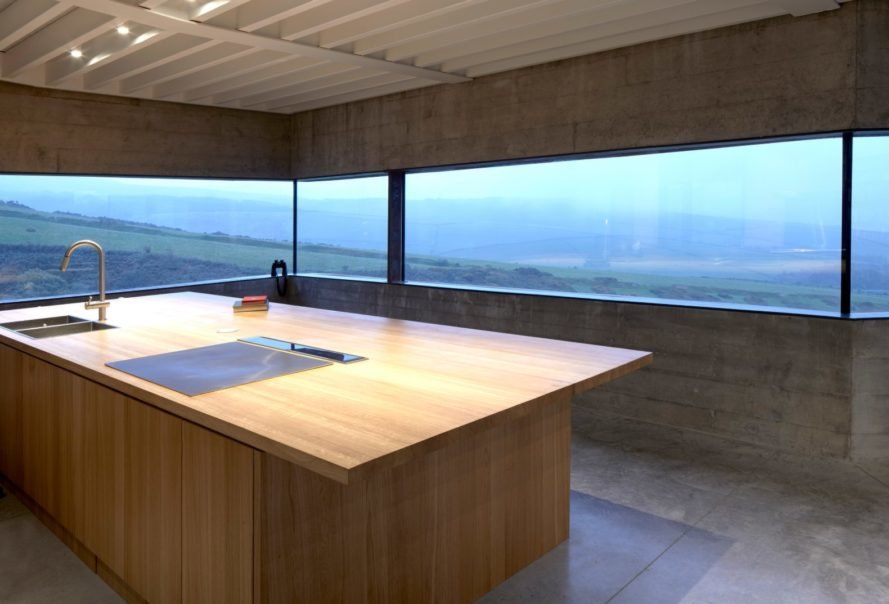 large kitchen island surrounded by glass walls
