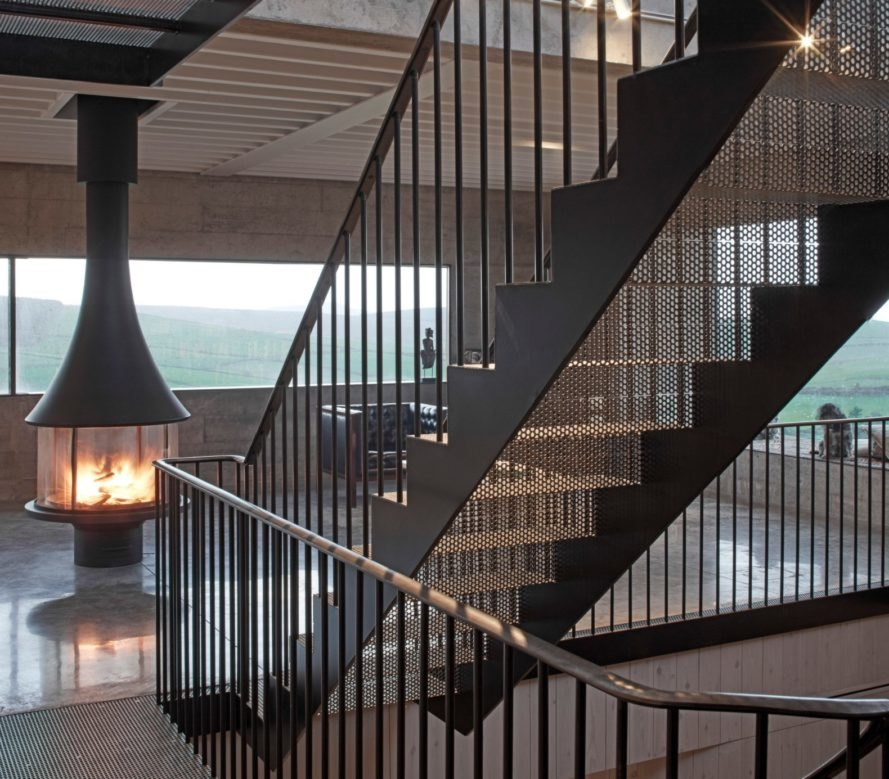 metal stairwell in living space with chimney