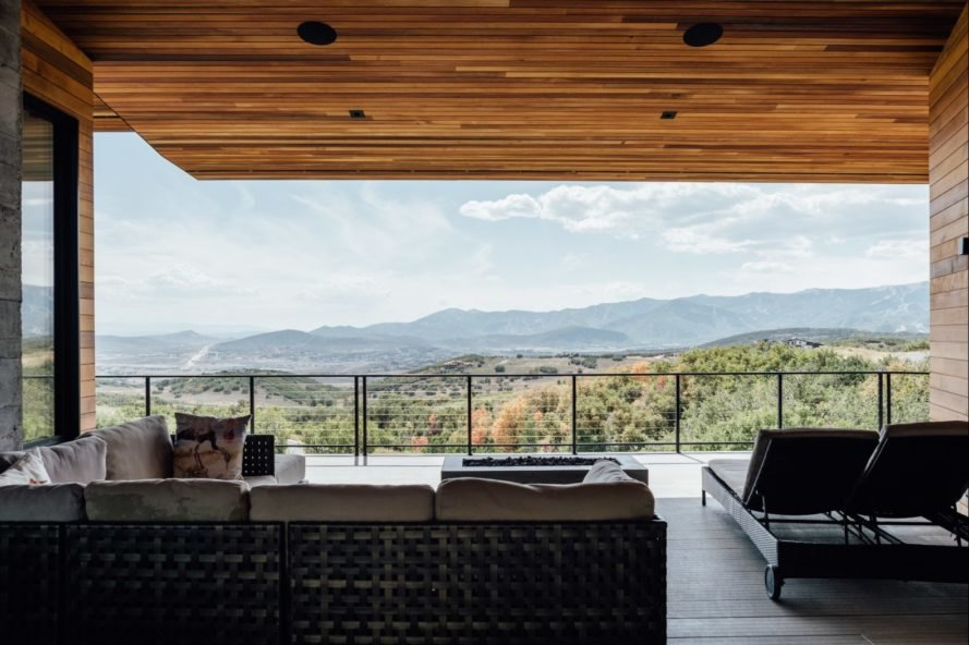 a view of the mountains in the distance from outdoor deck with sectional couch