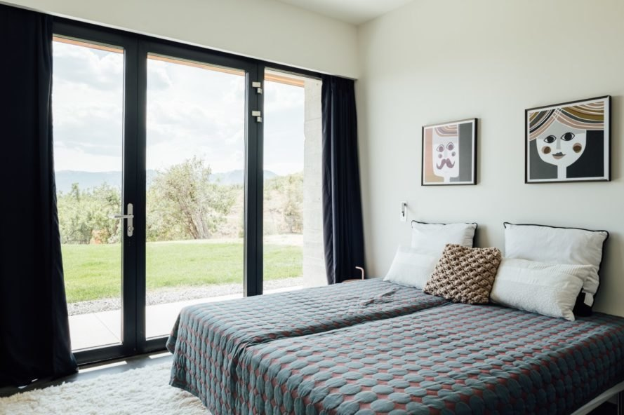 bedroom with two single beds and large sliding glass door