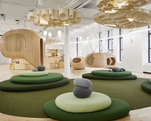 bright room with timber and green furnishings