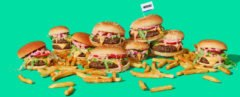 cheeseburgers and fries on a teal background
