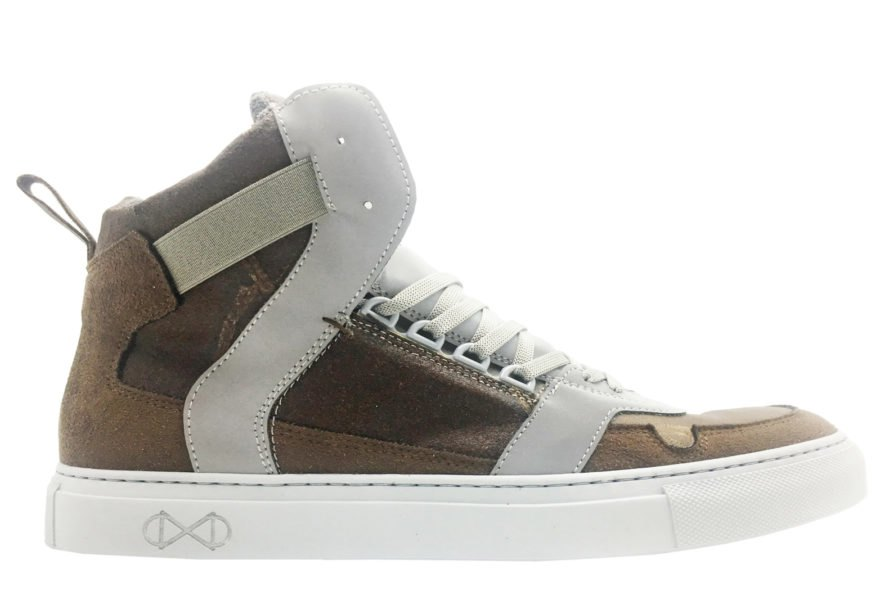 side view of brown high-top sneaker on white background