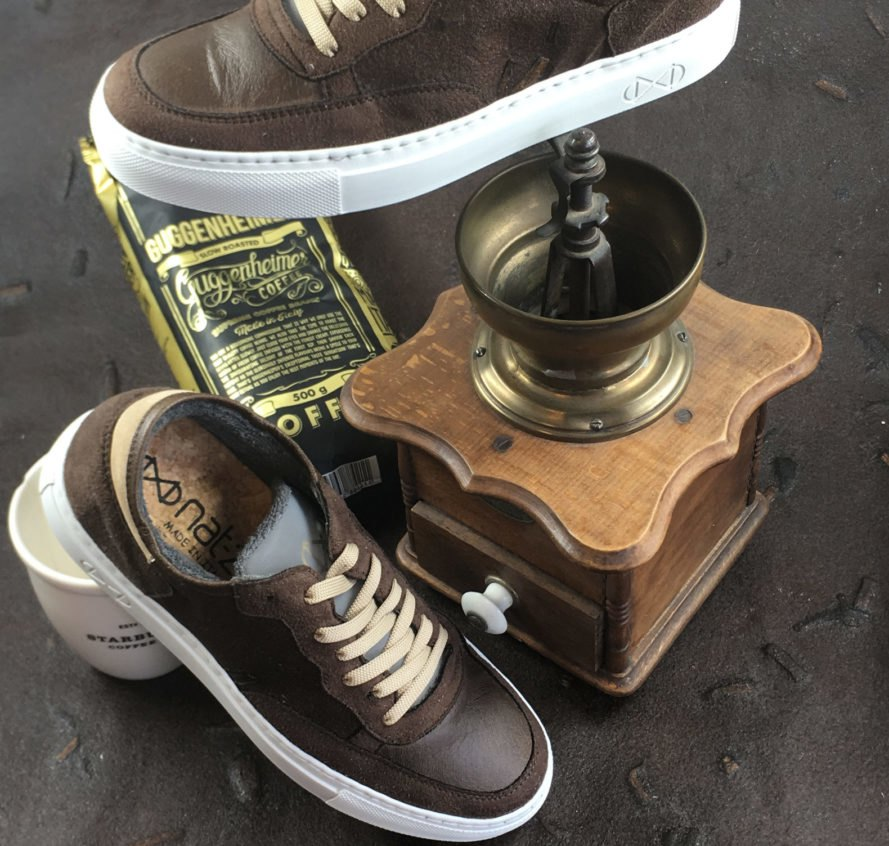 two brown vegan leather sneakers near bag of coffee