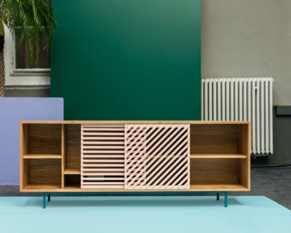 minimalist wood TV stand with pink slatted sliding doors