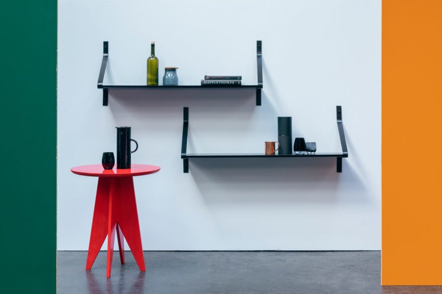 dark shelves and a bright red table