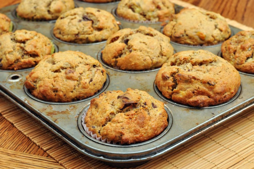 banana nut muffins in a muffin tin