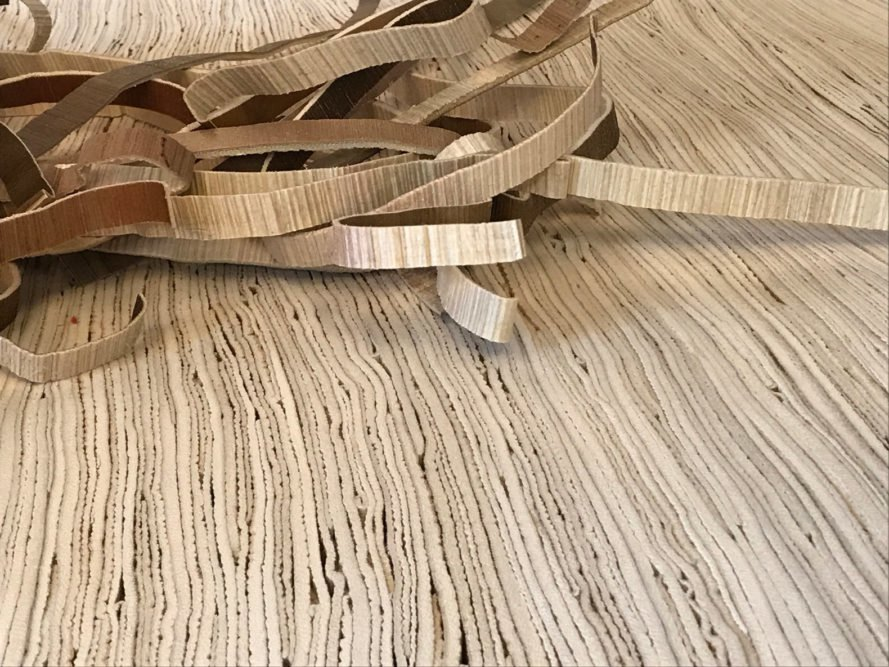 palm leather being cut into strips