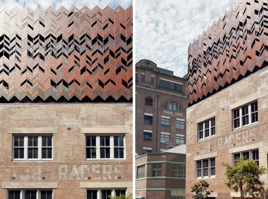 old brick warehouse with a chevron copper roof