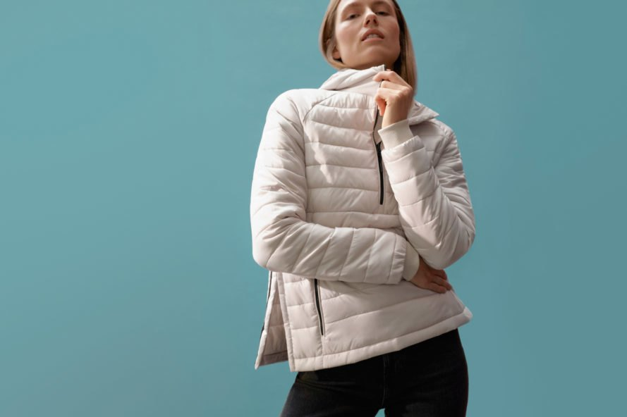 person wearing a white puffer jacket
