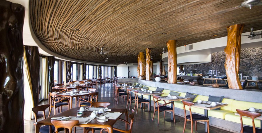 Restaurant with bar seating and bamboo roof