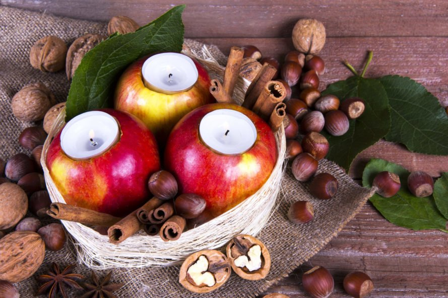 apples carved open to hold candles