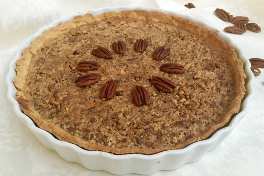 pecan pie in a white dish