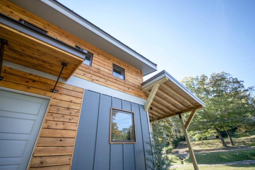 cedar home with blue highlights