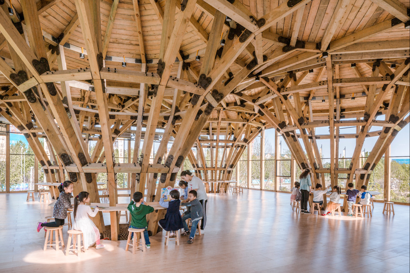 Glass building in China is filled with timber pillars in ...