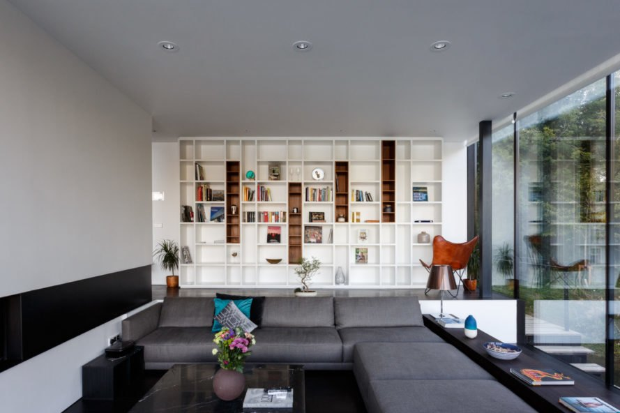 living room with floor-to-ceiling bookcase