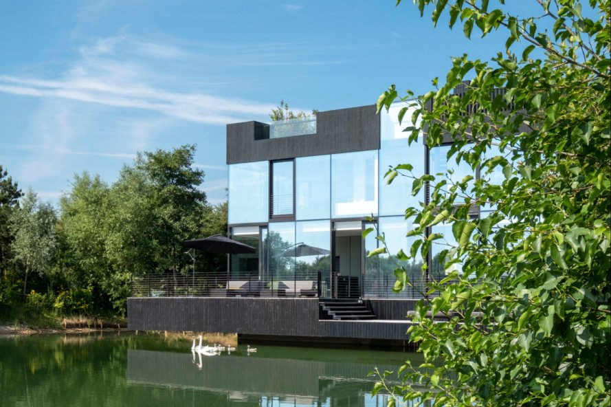 cube glass home on a lake