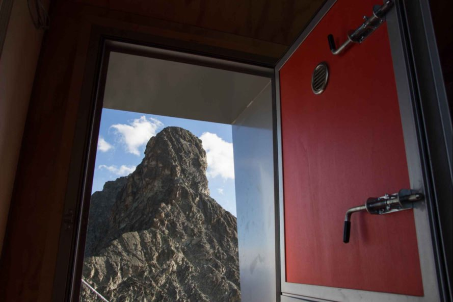 open door with views of mountain peak