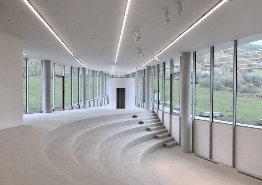 all-white room with several stairs and glass walls