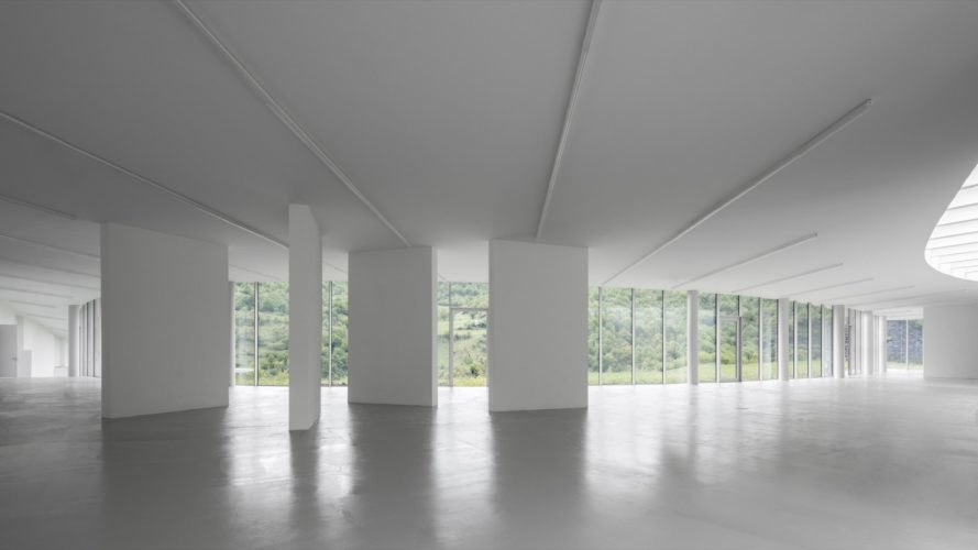 all-white room with glass walls