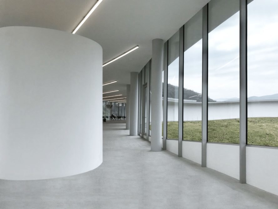 white room with glass walls