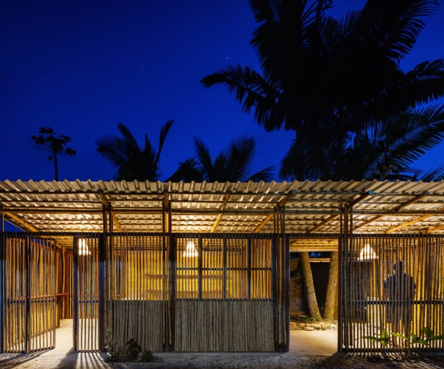 bamboo structure during the evening with light inside of the building