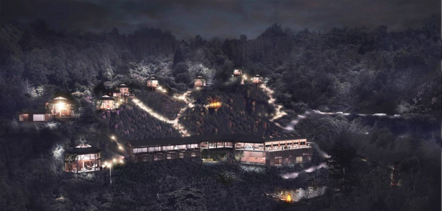 nightime image of hotel structure in the mountains
