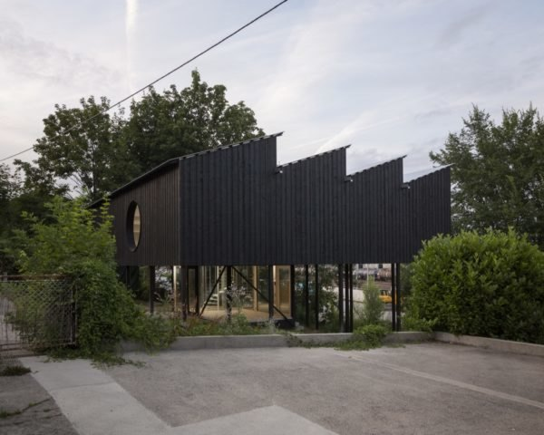 black home with jagged roof