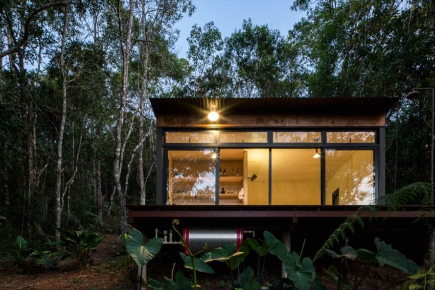 cabin with glass wall in a forest