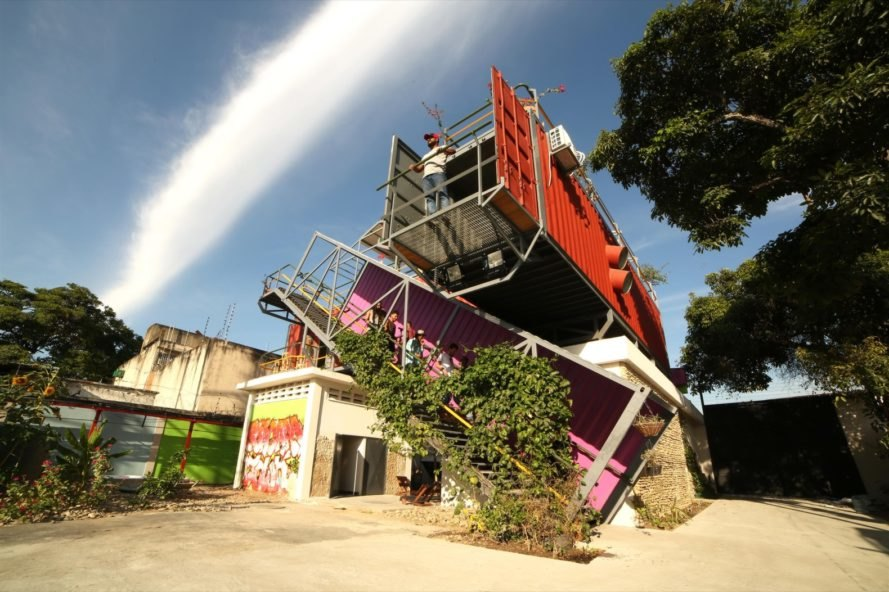 Stacked shipping containers transform into a thriving arts space in Venezuela
