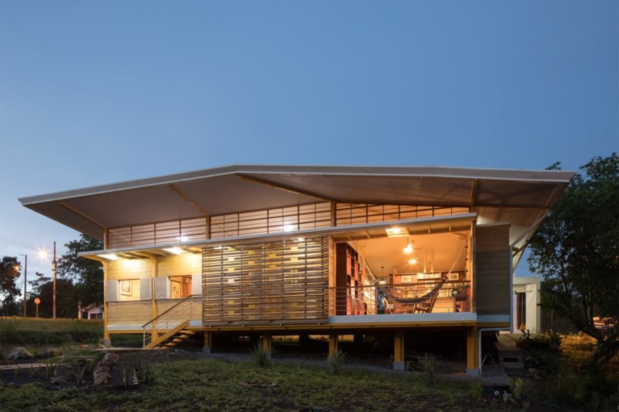 timber home elevated on tilts at night