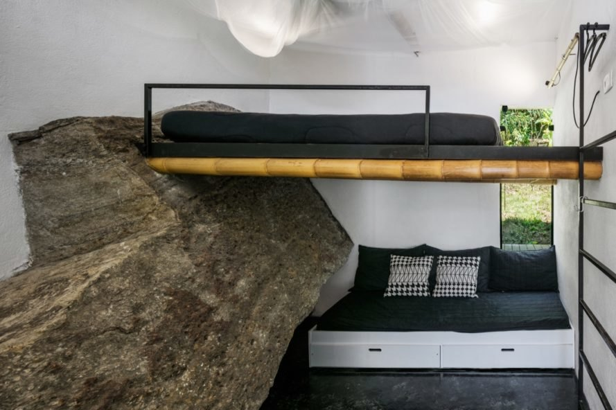 bunk bed above small sofa