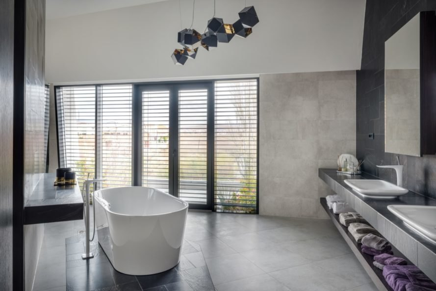 gray bathroom with free-standing tub