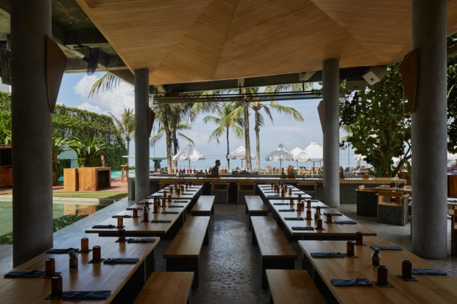 open air restaurant with rows of tables facing the ocean