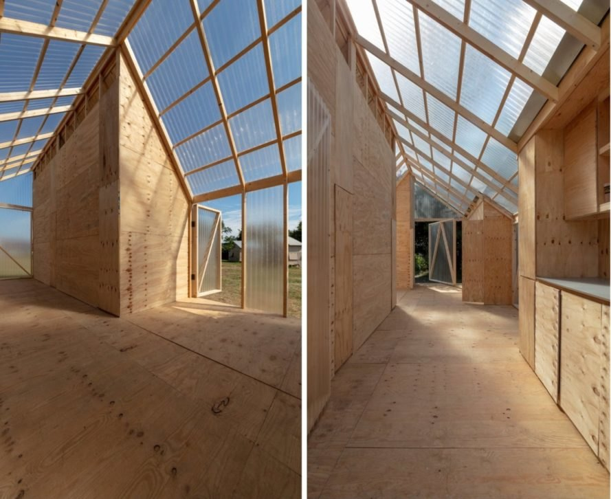wood-lined interior of a cabin with transparent ceiling