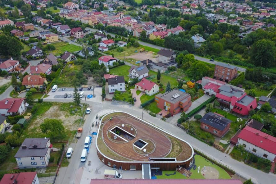 aerial view of triangular school building with green roof