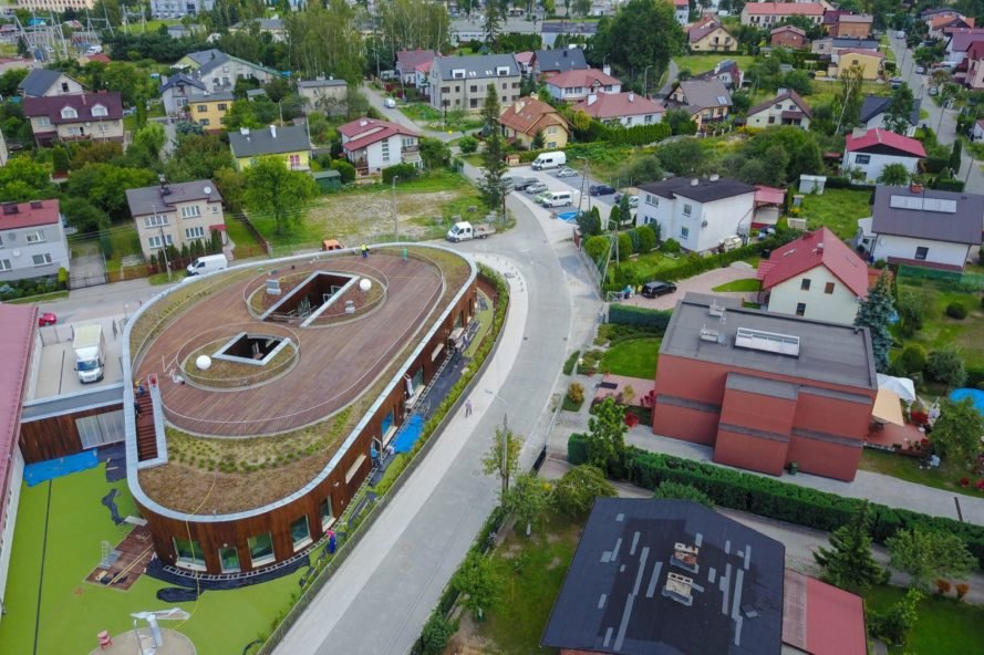 aerial view of triangle-shaped building with green roof