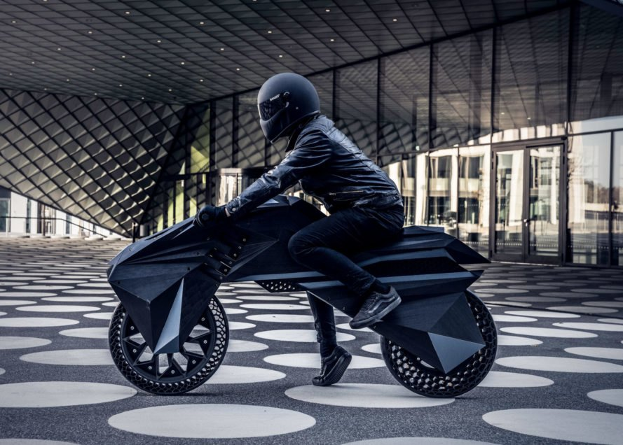 person sitting on black e-motorcycle