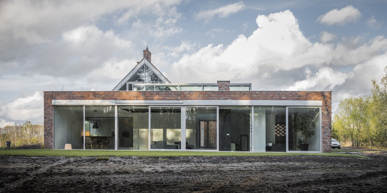 Green-roofed home is built of waste bricks and wood in Poland