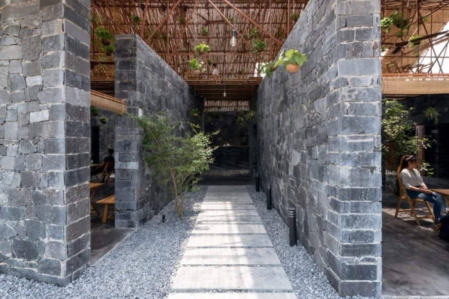 interior of s space with bamboo roof and recycled debris
