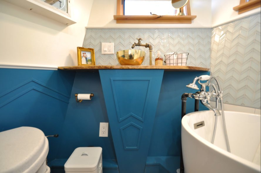 a bathroom with teal accents